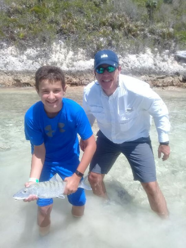 Kids fly fishing Bahamas Nassau